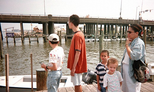 Bill, Chris, Tom, Lauren, and Mom standing on a dock