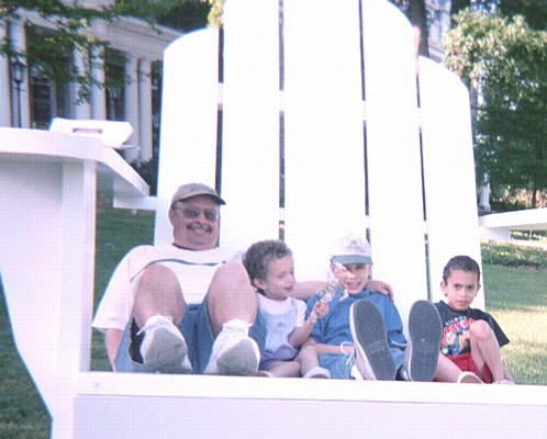 Dad, Lauren, Bill, and Tom on a large chair
