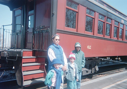 Mom with Lauren, Tom, and Bill in front of a train car