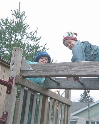 Thomas and Lauren on playground ladder