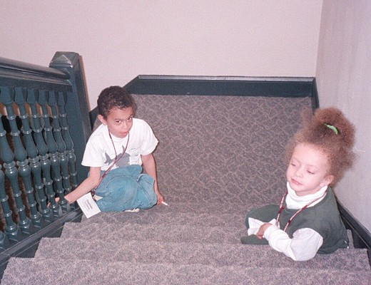 Thomas and Lauren sitting on stairs